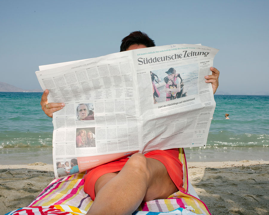 © Jörg Brüggemann/OSTKREUZ, Tourist Reading The Newspaper, Island Of Kos, Greece, August 2015