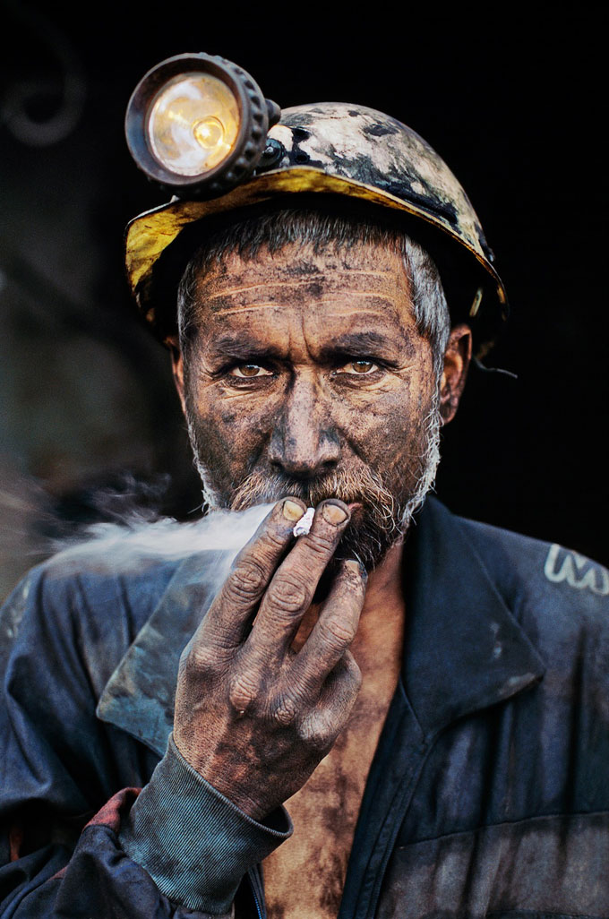 Smoking Coal Miner, Pol E Khomri, Afghanistan, 2002 © Steve McCurry
